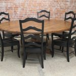 adorable natural 84 round dining table made of wood with black chairs with chevron style backrest with brick wall accent