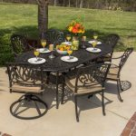 adorable outdoor dining set on patio with best furniture brands aside grassy meadow with black metal chairs and unique scrolled table