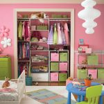 adorable pink closet organizer for small closet with green color accent and racks and storage bin and metal racls and blue round table and green chair for kids