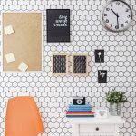 adorable white honeycomb patterned peel and stick removable wallpaper with target frame picture and cloc and orange chair and small white table