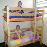 adorable wooden crib size bunk bed design with mini armoire and colorfl bedding sheet and black flooring and glass window