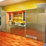 Adorable Yellow Painted Color For Kitchen With Stainless Steel Cabinet And Backsplash Storage And Hardwood Floor