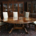Amazing 84 Round Dining Table With Glossy Look And White Chairs With Backrest And Wooden Frame On Patterned Area Rug Before Cabinetry With Glass Accent
