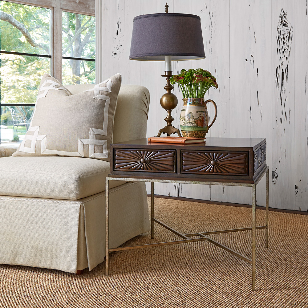 ambel campaign side table in traditional design with impressive drawers and wooden handle plus metal legs and decorative table lamp and vase plus beige rug