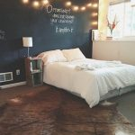 awesome bedroom decoration idea with white bedding and black wall and end table and string light and concrete flooring