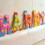 beautiful Harry large decorative letters design in colorful style with heart shaped pattern and funny face for kids decoration