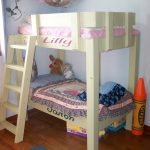 beautiful crib size bunk bed design with mini stairs and purple bedding and toy basket and hardwood floor and navy blue area rug