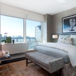 Beautiful Grey Benches For End Of Bed For Grey Color Scheme Bedroom With Grey Walls Natural Wooden Floor White Floor Lamp Grey Furniture