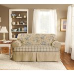 beautiful slipcover of loveseat and white rug on wood floor furniture shelfs table