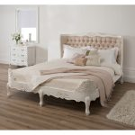 bed pillows bedsheet mirror cabinet rug flower