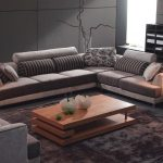 best sectional sofa for the money in grey scheme with impressive striped cushion and wooden coffee table and grey rug plus round end table with modern table lamp