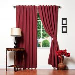 best sound reducing curtains in red decorated with round wood table in brown finishing plus table lamp and unique flower vase and wooden floor