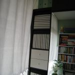 bins storage curtains boxes books plant laptop