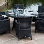 black bamboo glass round outdoor dining table for 6 set black simple classic bamboo chairs natural colors tile floor natural open space dining room