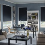 black roller shades blackout blinds modern black grey office room stainless steel chair frames wooden glass top table decorative blue flower wooden bookshelf grey floor