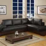 black sofa wood table rug lamp
