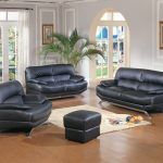 black sofas rug curtains