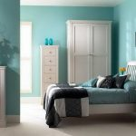 blue interior paint colors for 2014 for bedroom with white bedframe and wooden nightstand plus chest drawer and wooden dresser plus cupboard