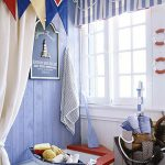 blue white stripes window treatment on the top of small windows blending greatly with room blue tones