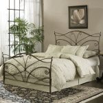 bronze metal adjustable bed frame ivory white cushion and bedsheet flower wall picture living plant flower motive carpet