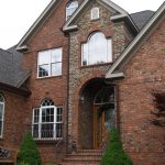 brown brick with stone home siding natural brick with stone home siding classic elegant house green plants