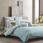butterflies motive soft blue organic cotton bed sheets natural wooden bedroom beautiful decorative yellow flower gray rug