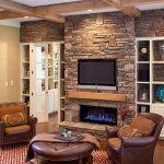 cabinet tv fireplace stone chairs pillows rug