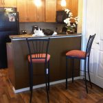 cat chairs kitchen table bar refrigerator wood