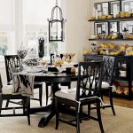 centerpieces for dining room tables on black finishing round wooden table with wooden chairs plus beige rug glass chandelier plus sideboard with pumpkin decoration