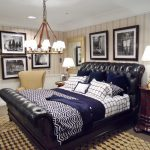 chandelier bed pillows chair lamp cabinet rug