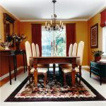 chandelier table chairs rug mirror cabinet