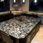 charming stone motive granite countertop for brown wooden kitchen cabinets and natural tile floor