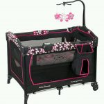 cheerful small pack and play idea in black color with pink accenta dn floral pattern quilt and toy holder and storage