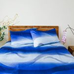 cheerful two tones blue organic cotton bed sheets beautiful decorative flowers wooden bedroom furniture