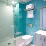chic glass enclosed showers adorable ocean blue walls white bathroom cabinet white tile floor