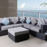 classic bamboo foam Thomasville outdoor furniture two tone colors table chair set blue grey stripped cushions open ocean space backyard natural color floor