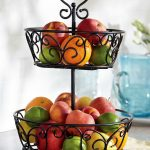 classic scrolled iron tiered fruit stand idea with two storey with holder and three legs