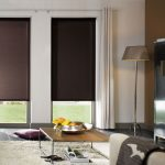 classic sleek grey ikea blackout blinds for clean modern living room  with beige sectional sofa wooden cupboard gold floor lamp and beige fur rug