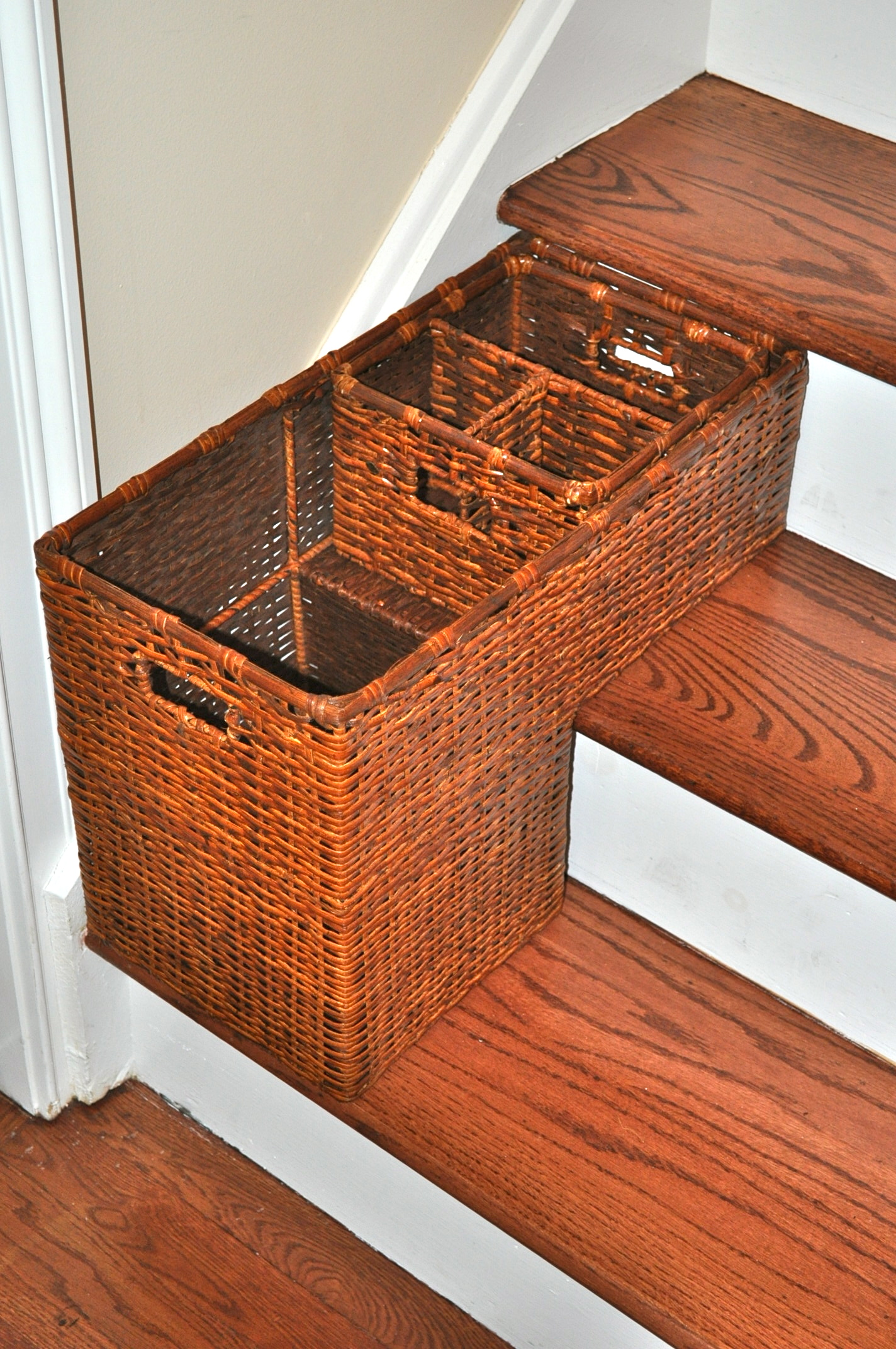 Attractive Classic Tone Basket Design For Stairs Made Of Rattan Material With Storage  Partition On Wooden Steps