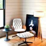 Classic Vintage Room Design With Vinyl Siding And Wooden Floor And Glass Window And Painting And Tripod Floor Lamp And Round Table And White Tufted Cozy Reading Chair