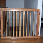 classic wooden baby gate for top stairs idea with carve pattern on wooden floor aside white wall