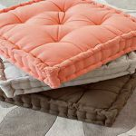 classy and matte floor pillows ikea design in peach gray and brown color with tuft pattern on patterned area rug