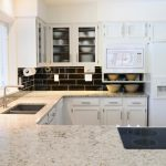 clean classic white granite countertop for white kitchen with white cabinets