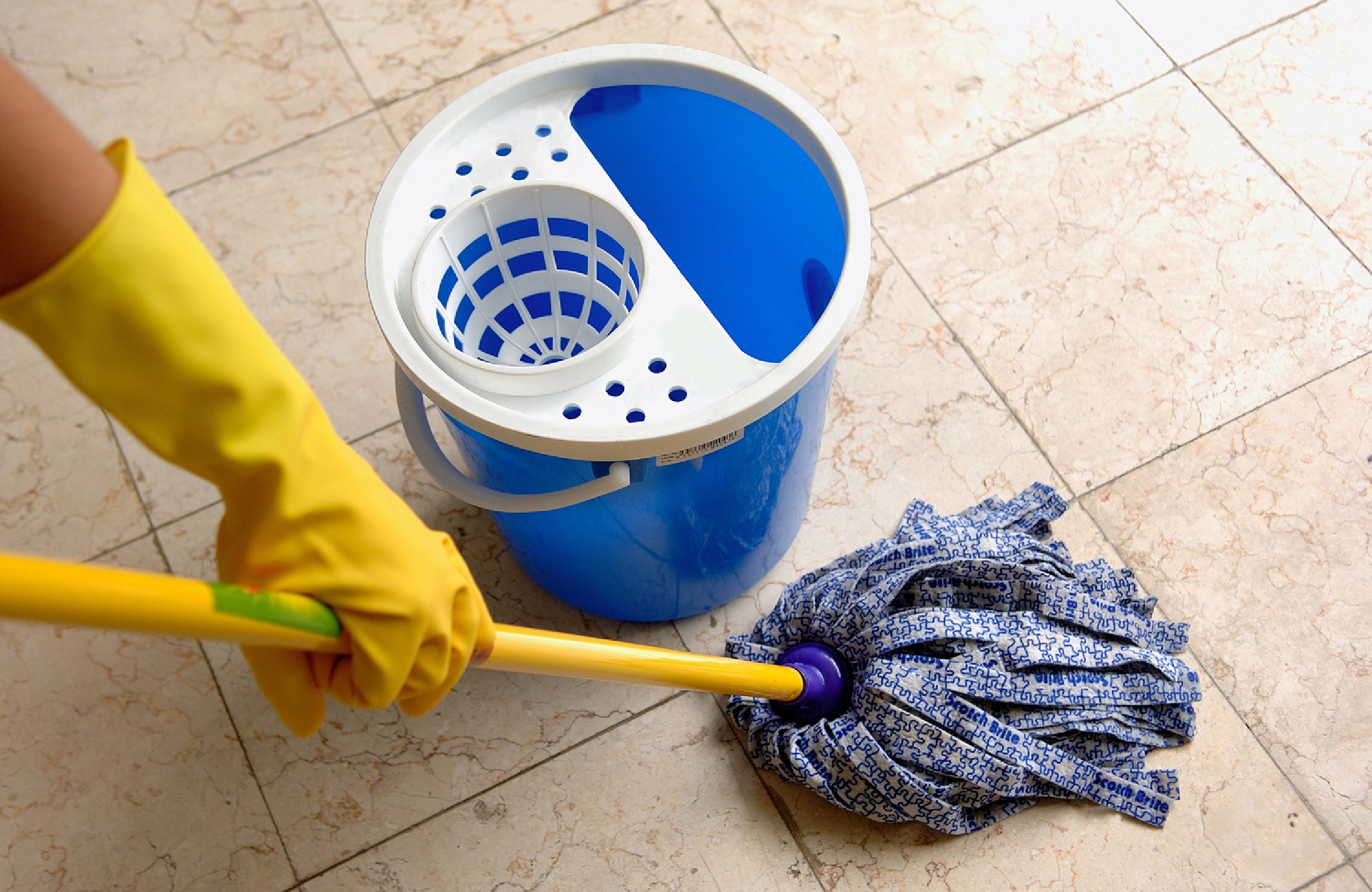 Simple routines to cleaning ceramic tile floors homesfeed cleaning ceramic tile floors by wet mopping with water and cleaning products white blue bucket dailygadgetfo Images