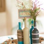 colorful wine bottle decorating ideas for fall design in gray white and blue with zig zag pattern and flower for table centerpiece