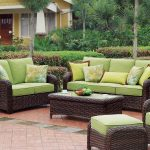 comfortable outdoor seating idea with best patio furniture brands of rattan sofa with green bolster and rectangle rattan sofa and footrest and lush vegetation