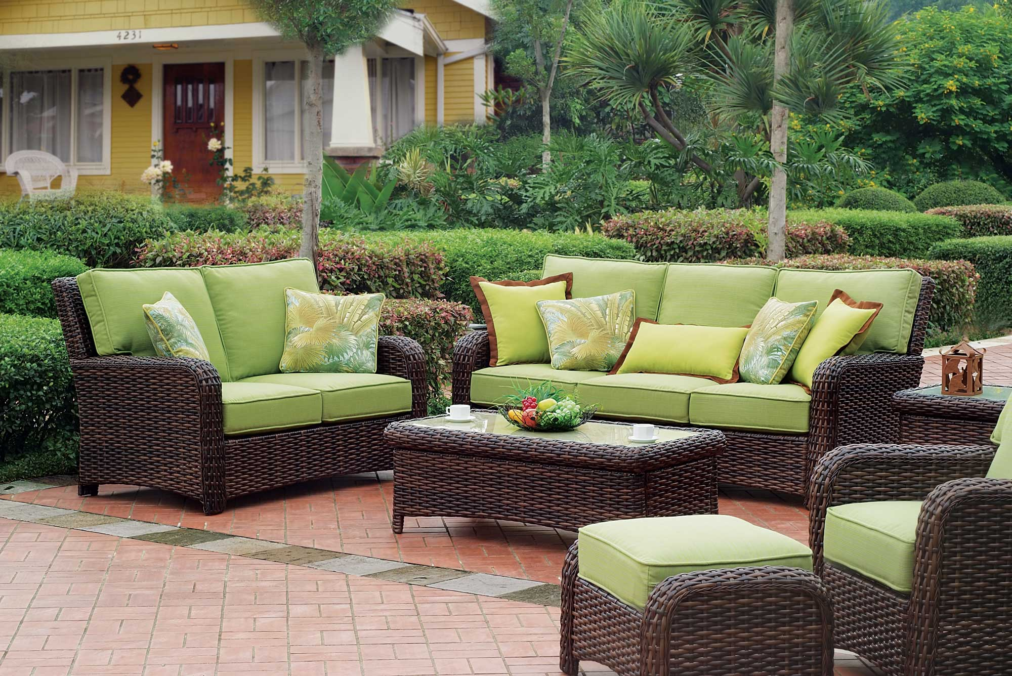 comfortable outdoor seating idea with best patio furniture brands of rattan sofa with green bolster and - Best Outdoor Patio Furniture