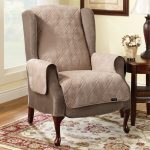 comfortable wingback chair slipcover design with wooden carved legs with wooden side table and patterned area rug and glass window and carper