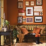 pictures wall sofa pillows table plants rug