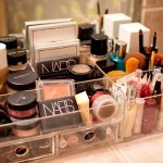 compact makeup organizing idea with acrylic storage desgn with plots and some makeup tools